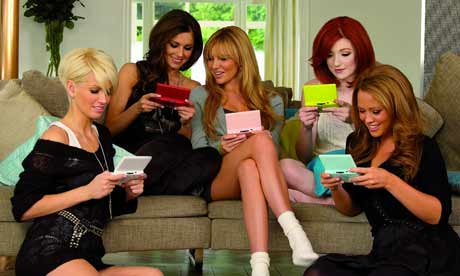 Girls Aloud, all managing to hold it the right way up/around