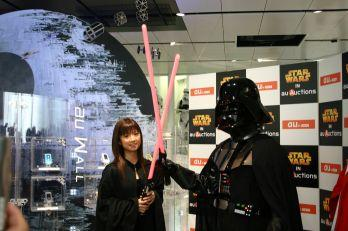 There's another picture (an ACTUAL ADVERTISMENT) of two teenage girls showing Vader pictures they've taken on their mobile phones, but even we don't hate Star Wars fans that much.